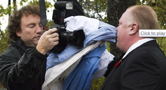 Rob Ford pushes the press off his property October 31, 2013 | Image: cbc.ca video screen grab